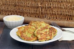 Healthy Zucchini Fritters with a side of parmesan cheese. Royalty Free Stock Image