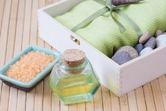 Healthy outfit for relaxation and SPA procedures with towel, stones and body oil stock image