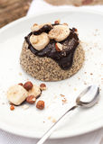 Healthy paleo cake with dark chocolate, banana and hazelnuts Royalty Free Stock Photo