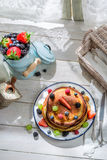 Healthy pancakes with berry fruits for breakfast Royalty Free Stock Photos