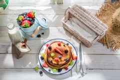 Healthy pancakes with fresh fruits for breakfast Stock Photography