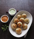 Healthy Paniyaram. Low fat lentil rice flour and vegetables dumplings Royalty Free Stock Image