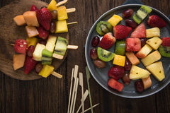 Healthy party snacks, fruit kebabs Royalty Free Stock Photos