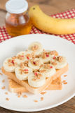 Healthy peanut butter and banana sandwich, muesli crisp with b Royalty Free Stock Photography