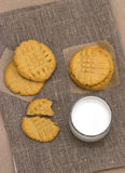 Healthy peanut butter cookies and milk on linen napkin Stock Photos