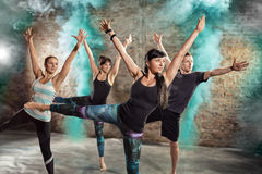 Healthy people body balance exercise. Healthy young people doing body balance exercise Royalty Free Stock Photo