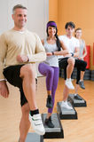 Healthy people doing exercises at gym royalty free stock image