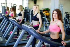 Healthy people doing fitness exercise in a sport center. royalty free stock images