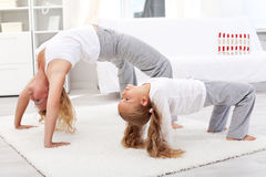 Healthy people doing gymnastic exercises at home Royalty Free Stock Image