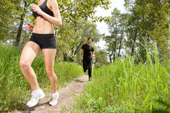 Healthy people jogging in forest Royalty Free Stock Photography