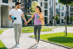 Pleasant fit couple leading healthy lifestyle. Healthy people. Pleasant fit couple going to the workout while leading healthy lifestyle royalty free stock photography