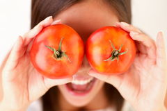 Healthy people: Tomato woman fun Royalty Free Stock Photography