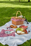 Healthy picnic food with fruit, cheese and bread Stock Photos