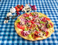 Healthy pizza with salami mushroom and vegetables royalty free stock images