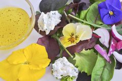 Healthy plate. Fresh green salad with garden flowers Royalty Free Stock Photo