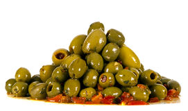 Healthy plate of olives in oil. OLIVES ON A PLATE WITH HERBS with Peppers Royalty Free Stock Photography