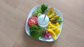 Healthy plate. Vegetables and fruit on a plate stock images