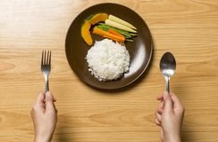Healthy plate, white rice, carrots, baby corn set on plate on wooden stock image