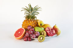 Healthy platter of whole mixed fruit on white background Royalty Free Stock Photo