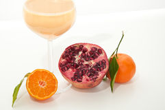 Healthy pomegranate smoothie. Healthy orange, pomegranate and kefir yogurt smoothie milkshake. Served with fresh sliced orange and whole pomegranate. Isolated on Stock Image