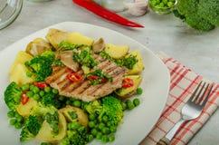 Healthy Pork Escalope with Super Greens Stock Photos