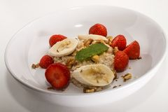 healthy porridge, scottish breakfast with strawberries and banana stock photography