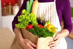 Healthy positive happy woman holding a paper shopping bag full of fruit and vegetables Royalty Free Stock Images