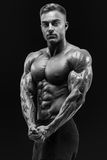 Healthy power shirtless young athletic man with strong abs and c. Black and white shot of healthy power shirtless young athletic man with strong abs and core Royalty Free Stock Photo