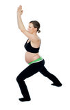 Healthy pregnant woman doing gymnastics Stock Photography