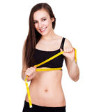 Healthy pretty woman measuring her waist Stock Photo