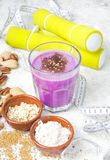 Healthy protein blueberry drink with oatmilk and nuts. Healthy protein blueberry drink with oat milk and nuts royalty free stock image