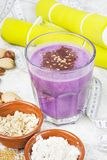 Healthy protein blueberry drink with oatmilk and nuts. Healthy protein blueberry drink with oat milk and nuts stock images