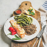 Healthy protein rich dinner plate with roasted salmon and quinoa. Healthy protein rich dinner plate. Oven roasted salmon fillet with multicolored quinoa, chilli Stock Image