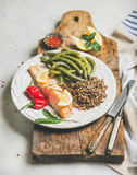 Healthy protein rich dinner plate with salmon and quinoa. Healthy protein rich dinner plate. Oven roasted salmon fillet with multicolored quinoa, chilli pepper Stock Image