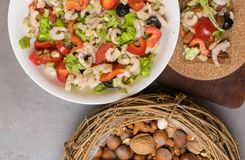 healthy protein salad with shrimps, tomatoes, avokado, lettuce, oil, olives in high protein biscuits. Wooden background. Vegan foo stock photography