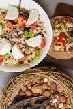 healthy protein salad with shrimps, tomatoes, avokado, lettuce, oil, olives in high protein biscuits. Wooden background. Vegan foo stock photo