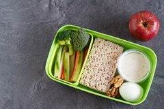 Healthy protein and veg diet snack box for lunch. With egg, nuts, multigrain crackers and vegetables Royalty Free Stock Photo