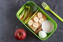 Healthy protein and veg diet snack box for lunch. With egg, nuts, multigrain crackers, peanut butter, banana and vegetables Stock Photography