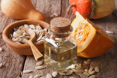 Healthy pumpkin seed oil close-up with the ingredients. horizont Stock Photos