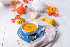 Healthy pumpkin soup with ginger carrots and coconut milk royalty free stock photo