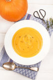 Healthy pumpkin soup with thyme in a deep plate Royalty Free Stock Image