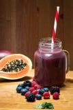 Healthy purple fruit  juice Stock Images