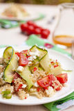 Healthy quinoa salad. Refreshing and healthy quinoa salad with zucchini and tomatoes Stock Photos