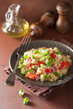 Healthy quinoa salad with tomato cucumber onion chives Royalty Free Stock Images
