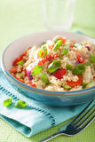 Healthy quinoa salad with tomato cucumber onion chives Stock Images