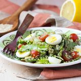 Healthy quinoa salad with tomatoes, avocados, eggs, herbs. Lettuce, lemon, diet dish Stock Photography