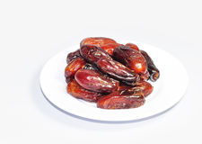 Healthy Ramadan Dried Dates Fruit on plate. Dried Dates fruit for Ramadan break fasting royalty free stock images