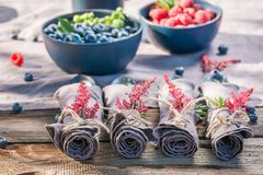 Healthy raspberries and blueberries on old wooden rustic table. Session in outside Stock Image