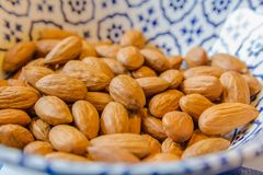 Healthy raw almonds piled into a bowl ready for eating. Fresh raw almonds served in a bowl closeup Stock Photo
