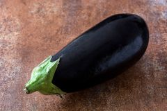 Raw eggplant on rustic background. Healthy raw eggplant on rustic backgroundn Royalty Free Stock Images